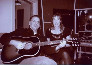 "In the studio with John Hiatt singing and playing on ""World Of Hurt"" from Deeper Still 2000."
