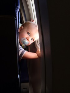 My grandson Atreyu looking very focused on his first airplane ride!