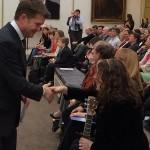 Shaking the hand of Ambassador Matthew Barzun at the American Embassy after singing for NASA.