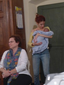 Andi watches while Serena soothes the baby.