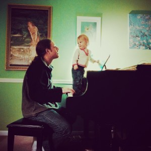 Trey and his Dad consulting on chord progressions.
