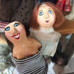I made these twins out of paper mache in high school. The torso sisters.