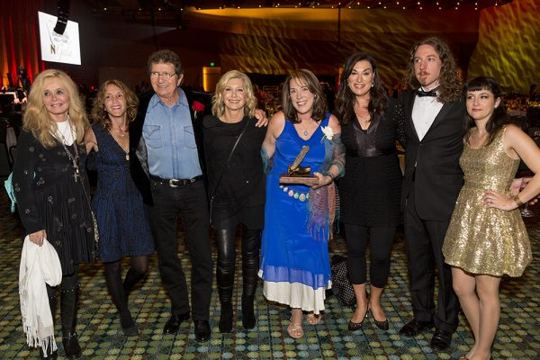 Backstage at induction with Kim Carnes, Annie Roboff, Mac David, Olivia Newton-John, Amy Sky, Ernest Chapman, and Jessie Friedman