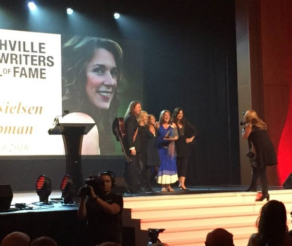 Hall of Fame onstage with Ernest, Olivia, Annie and Amy