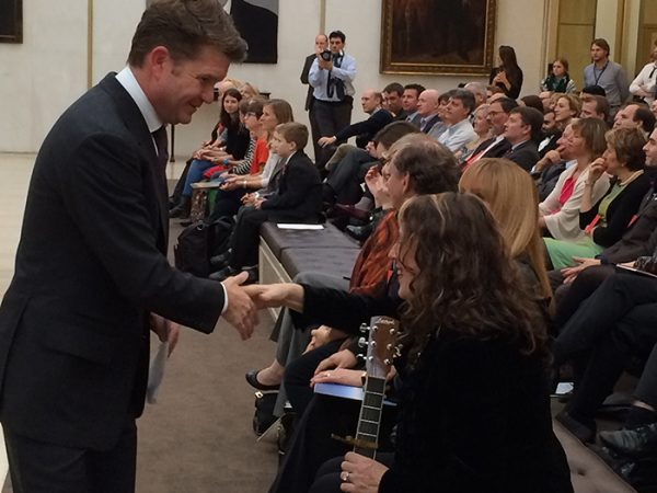Shaking the hand of Ambassador Matthew Barzun at the American Embassy after singing for NASA.